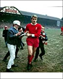 Photographic Print of Roger Hunt signs autographs for young fans from Liverpool FC Pictures