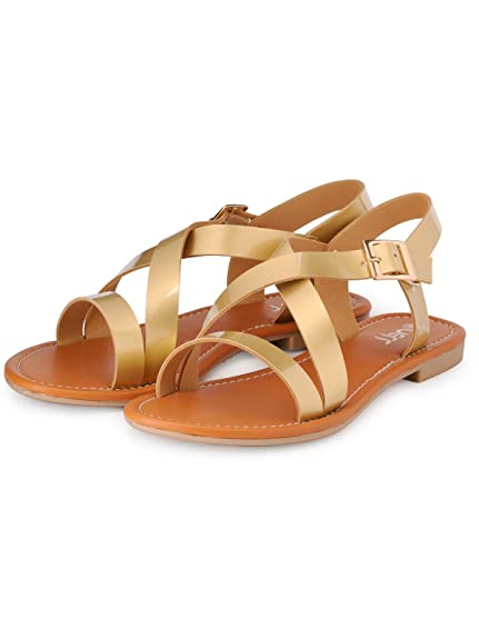 Nell Women Gold Flat Sandals available at Amazon for Rs.599
