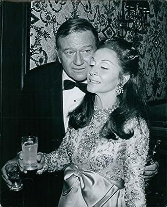 John Wayne with his wife Pilar Pallete at Governor's Ball. - 8x10