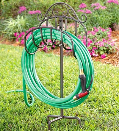Wrought iron portable hose holder with stake in green for Garden hose stakes