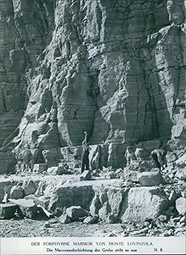 vintage-photo-of-men-breaking-the-mountain
