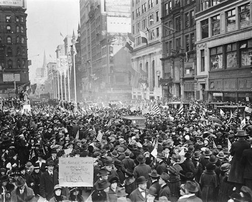 Americans celebrate Armistice Day in the streets of New York City at the 11th hour, of the 11th day, of the 11th Month, 1918.