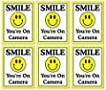 "6 Pack of Large (4"" Wide x 5"" Tall) ""Smile You're On Camera"" Video Surveillance Security Decals Door Window Wall Vinyl Stickers for Indoor/Outdoor Use; Adhesive on Back"