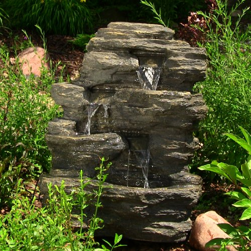 Water fountains for the yard for Stone garden waterfall