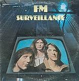 FM: Surveillance LP VG++/NM Canada Passport PB 2001