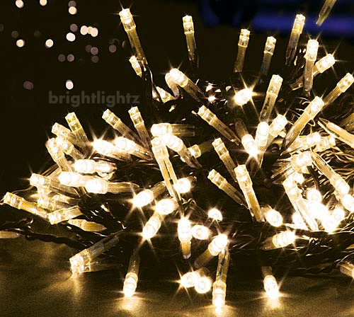 10M 100 LED FAIRY STRING TWINKLE LIGHTS WITH 8 FUNCTIONS IN WARM WHITE ** FULLY WATERPROOF SEALED ON DARK HEAVY DUTY CABLE - CREATE A BEAUTIFUL EFFECT IDEAL FOR CHRISTMAS TREE LIGHTS, FESTIVE LIGHTS, WEDDINGS, ETC **