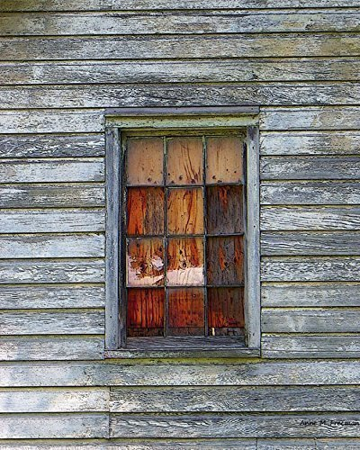 barn-window-with-plywood-a-fine-art-photograph-of-an-old-barn-window-with-stained-plywood-and-weathe