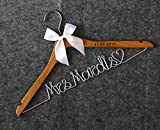 Thanks for choice our wedding hangers, Our hangers made of the wood , We support the DIY the hangers , When you order it , You can choice the Hanger color Bow clolor ,after order just send the message to us about the ganger color and bow clol...