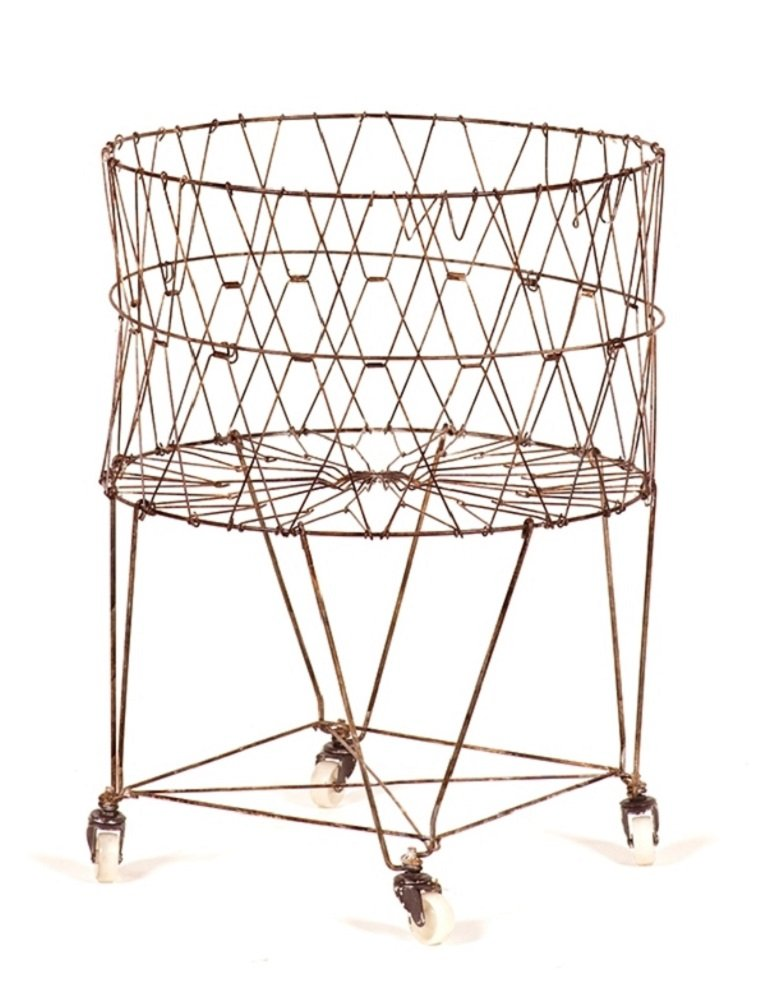 "wire laundry basket on rollers collapses to just 4"" high - recommended by linenandlavender.net - sold here:  http://www.amazon.com/gp/product/B004FH5WBG/ref=as_li_tl?ie=UTF8&camp=1789&creative=390957&creativeASIN=B004FH5WBG&linkCode=as2&tag=linenandlaven-20&linkId=CG5SPFXIYKGQ7MVG"