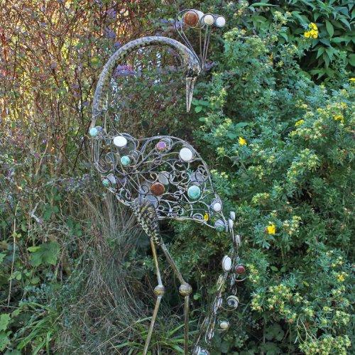 Backwards Facing Peacock Garden Ornament with Vintage Finish & Decorative Stones