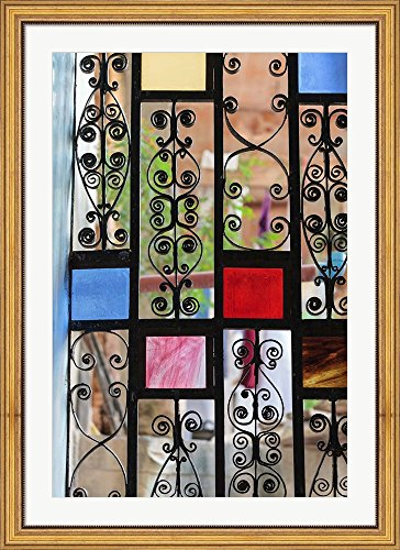Africa, Tanzania, Zanzibar, Stone Town. Stained glass and iron door. by Alida Latham / Danita Delimont Framed Art Print Wall Picture, Wide Gold Frame with Hanging Cleat, 32 x 44 inches