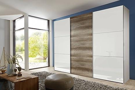 3-trg. Schwebeturenschrank in Alpinweiß, 2 Fronten in Glas weiß, 1 Front Wildeiche-NB, 3 E-böden und 3 Kleiderstangen, Maße: B/H/T ca. 313/236/65 cm
