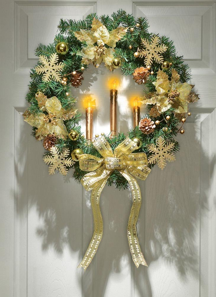 Gold Poinsettia Wreath With Lighted Candles