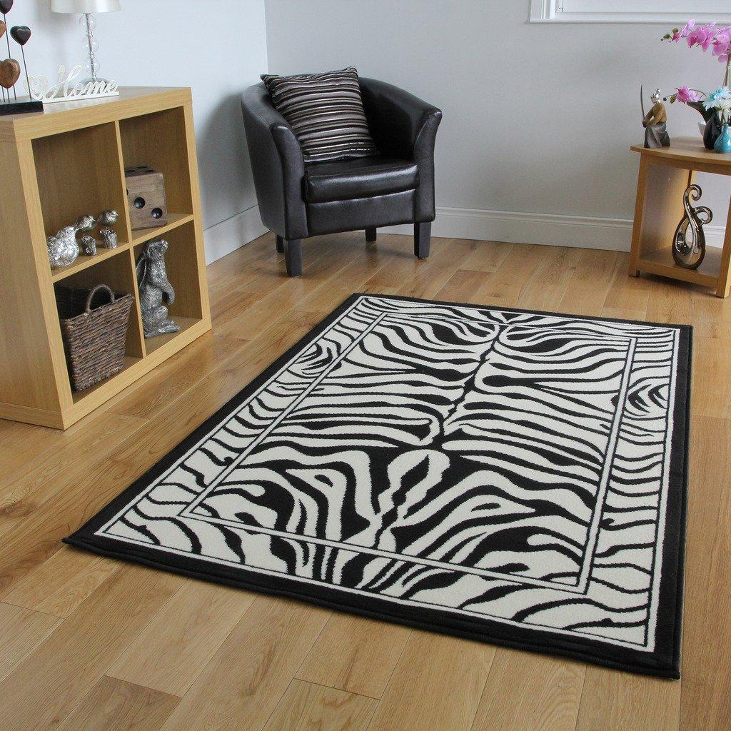 Alfombra Safari Animal Estampado Raya Cebra Blanco y Negro 63cm x 110cm (2 pies 1 x 3 pies 7)   Comentarios de clientes y más información