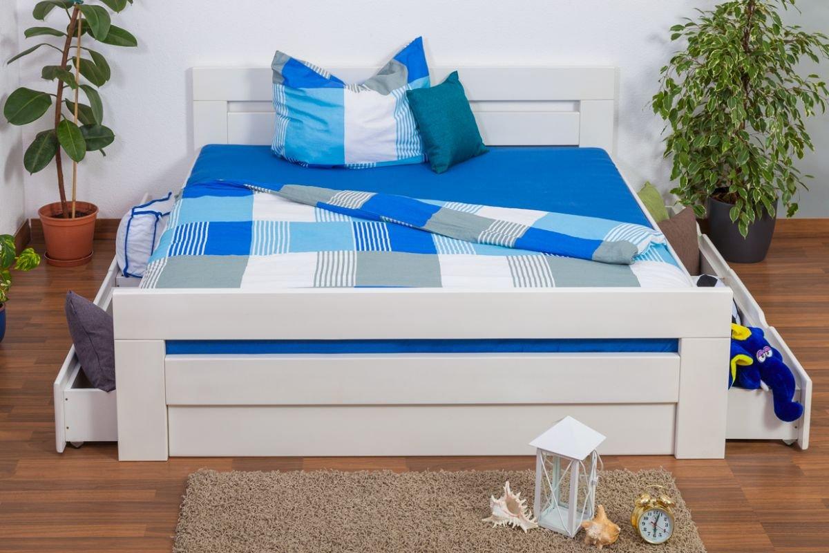 """Jugendbett """"Easy Sleep"""" K6 inkl. 4 Schubladen und 2 Abdeckblenden 180 x 200 cm Buche Vollholz massiv weiß lackiert jetzt bestellen"""