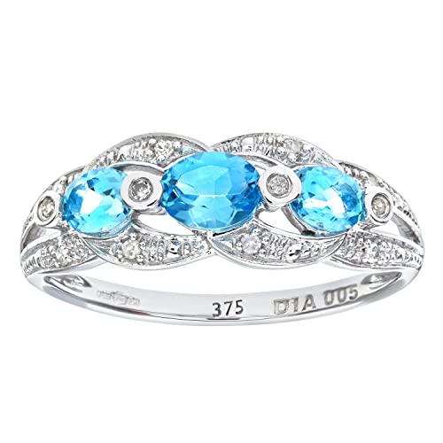 Naava 9ct White Gold Blue Topaz And Diamond Fig 8 Design Ring