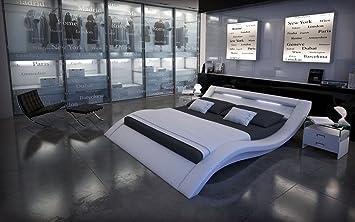 XXS® Möbel Design Bett Look weiß 140 x 200 cm inkl. LED Beleuchtung geschwungenes Design Lederlook Lager Speditionsversand