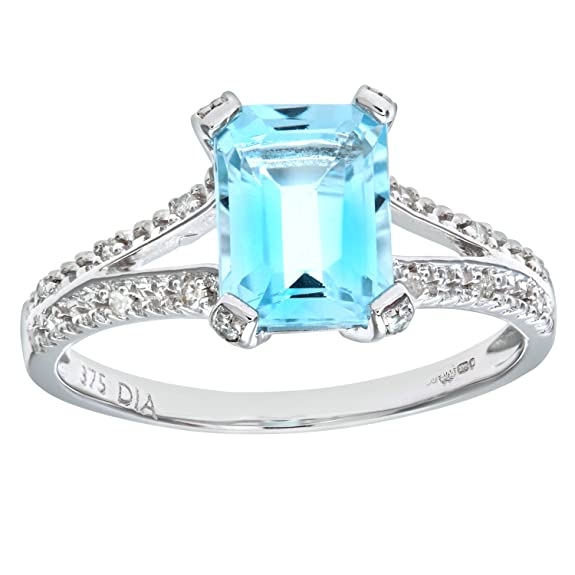 Naava 9ct White Gold Emerald Cut Blue Topaz Ring With Diamond Shoulders