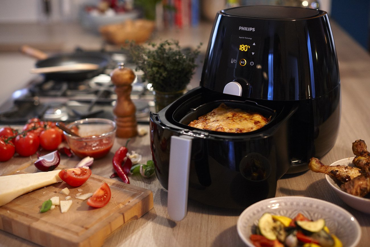 The Philips HD9230/26 Air Fryer comes with Rapid Air Technology and could be an excellent addition to your kitchen counter.