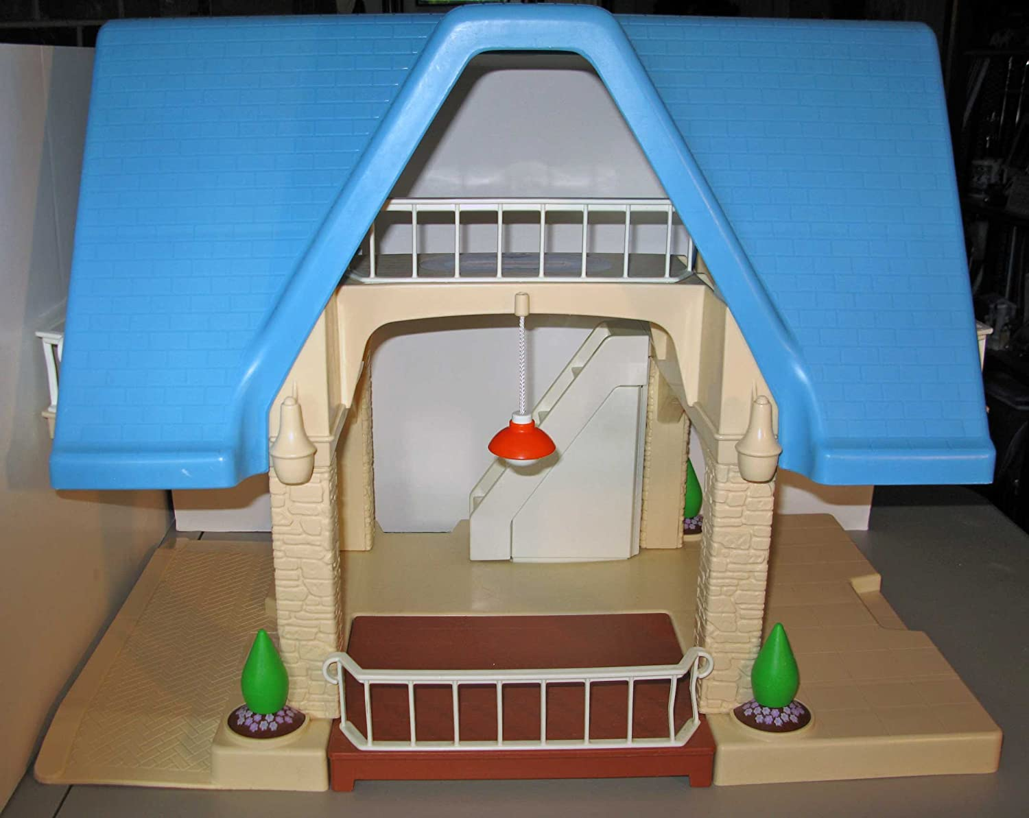 An Image of Vintage Little Tikes Dollhouse with Blue Roof
