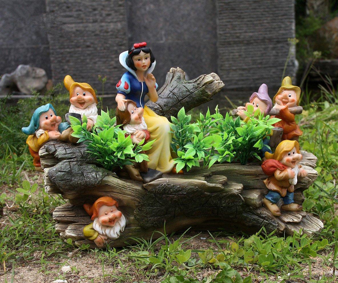 Скульптуры в саду своими руками фото