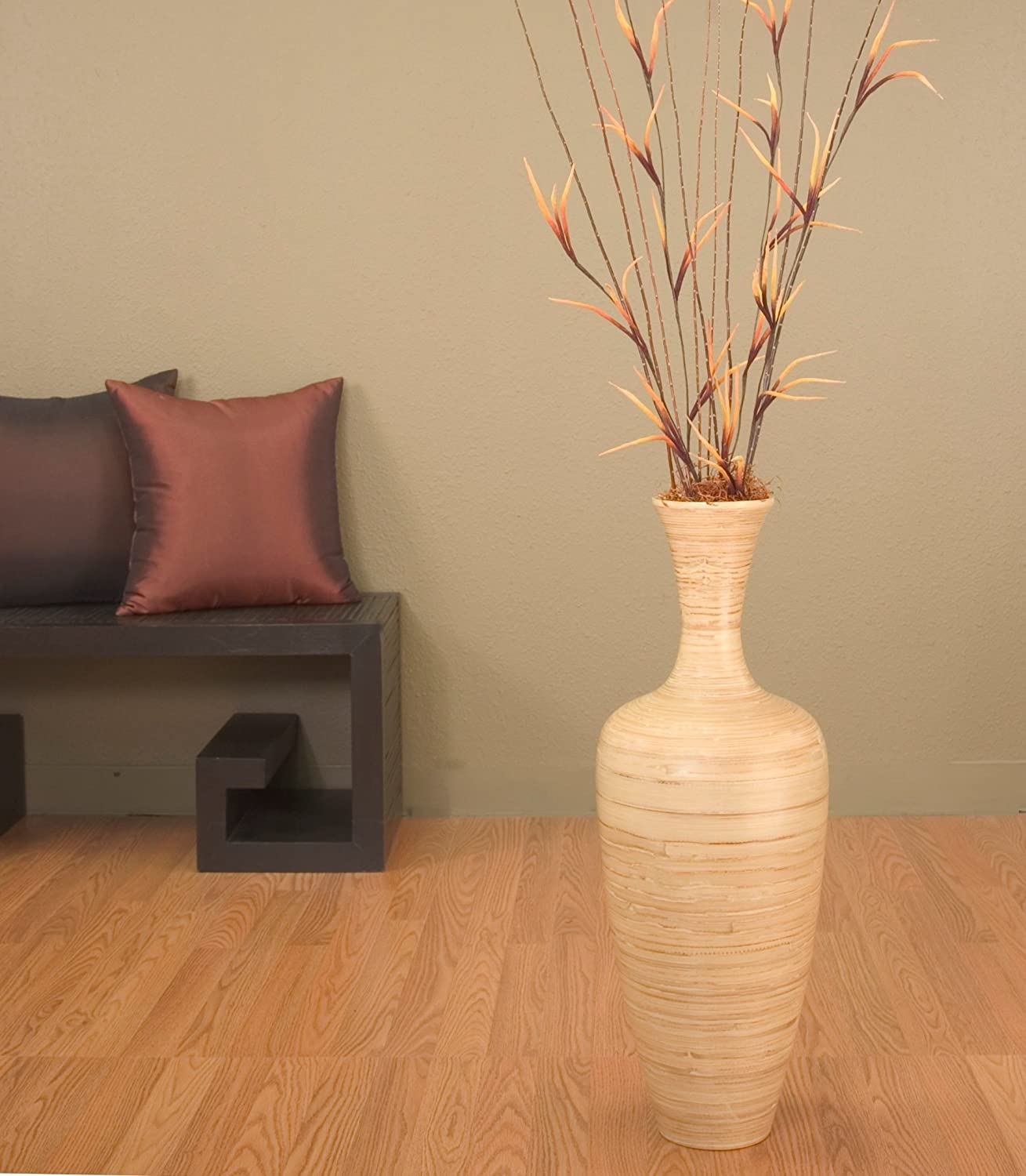Large decorative floor vases look lovely in a corner or a foyer. Place ...