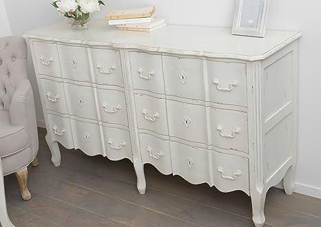 Cómoda larga de madera blanca envejecida con 6 cajones. Medidas: 140 x 40 x 80 cm.
