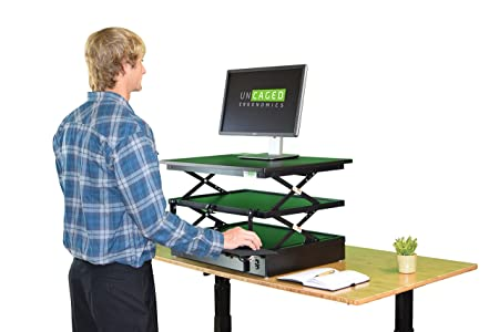 Uncaged Ergonomia elettrico changedesk altezza regolabile in piedi scrivania conversione, colore: nero