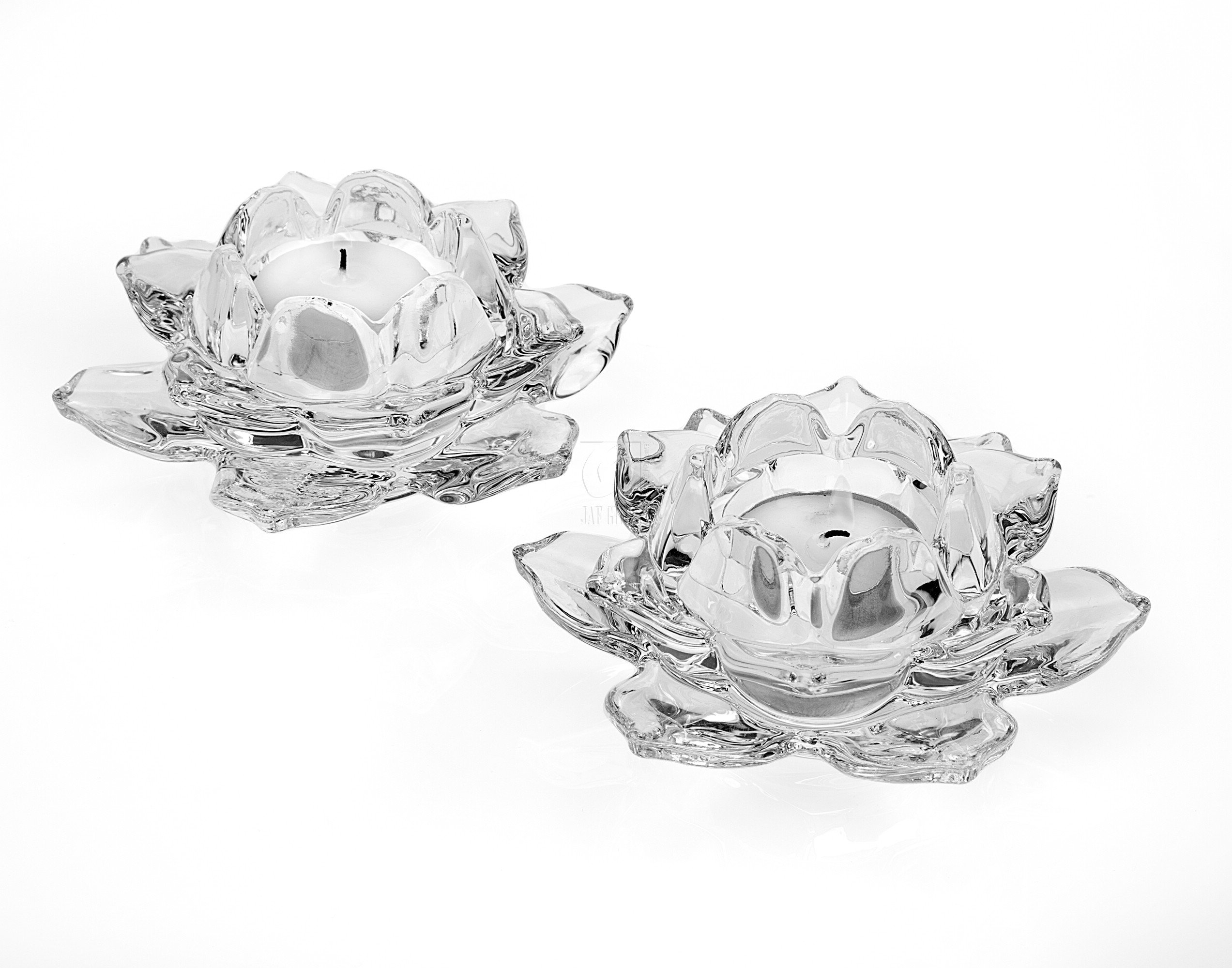 Created only in pairs, these gorgeous crystal candle holders bring a touch of elegance to any room
