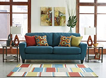 Ashley Sagen 9390238 Sofa with 4 Toss Pillows Uniquely Shaped Track Arms and Plush Loose Seat Cushions in