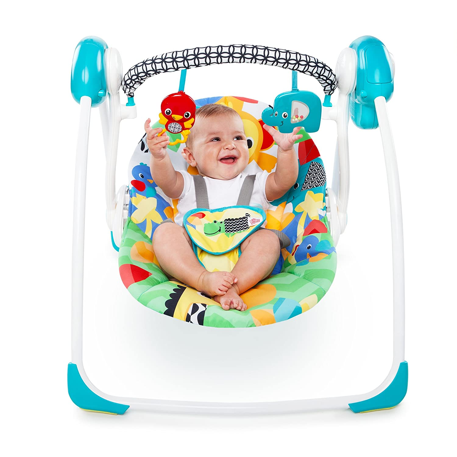 baby playing in compact/portable swing