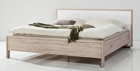 Letto matrimoniale color rovere naturale finitura vero legno con testiera laccata bianca lucida