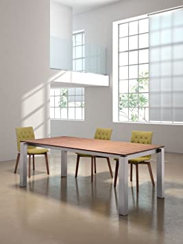 Copenhagen Dining Table Walnut. Like any good Dane, the Copenhagen Table has smooth lines and good design. Walnut finish tops stainless steel. Fits effortlessly into any space.