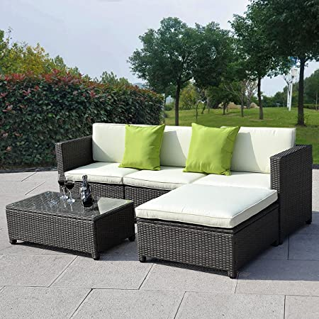 This outdoor patio furniture set comes complete with a three-seater sofa,  ottoman, table with tempered glass top, and seat and back cushions for each  seat. - The 50 Best Patio Furniture Sets & Pieces Of 2019 - Family Living Today