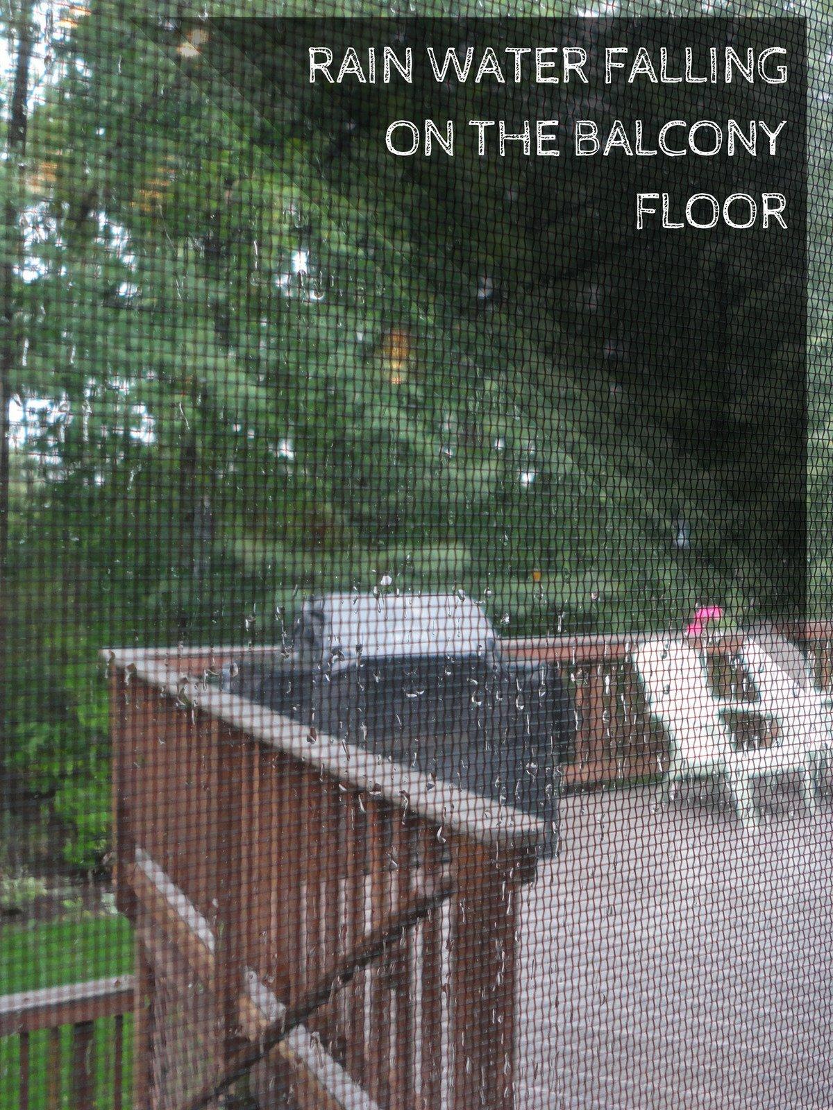 Rain water falling on the balcony floor