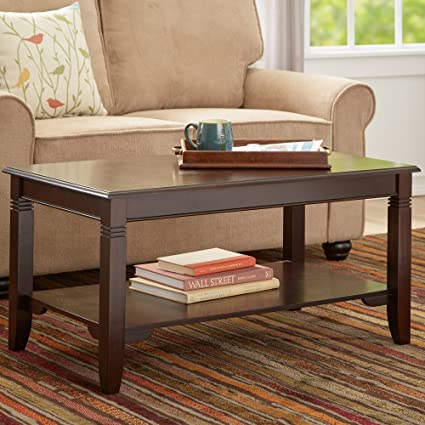 Coffee Table Classic Design and a Polished Cappuccino Finish Lend This Coffee Table a Timeless Look That Complements a Wide Array of Décor. The Lower Shelf Is a Convenient Spot for Accents, Books, and More