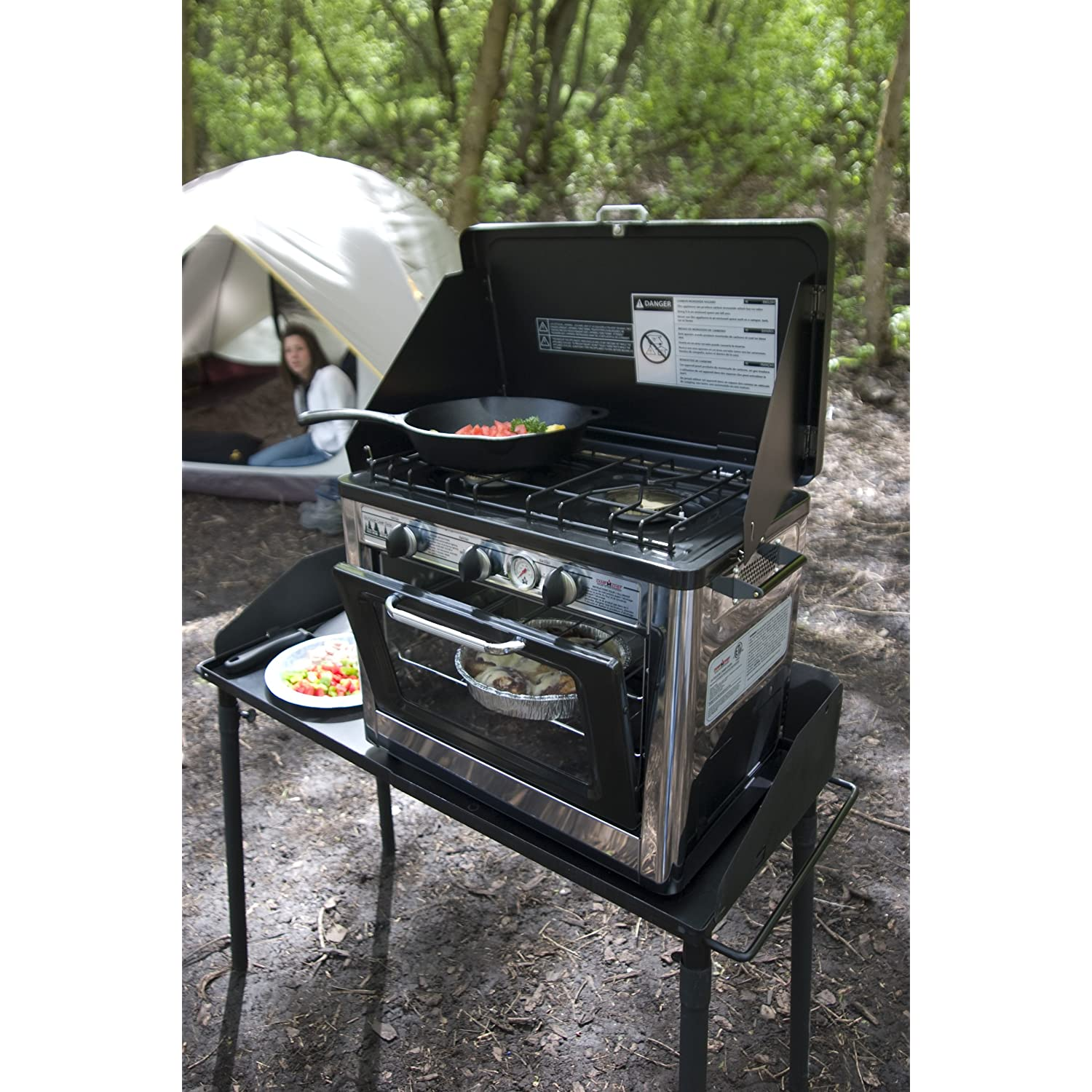 Camp Chef Outdoor Camp Oven 2 Burner is being used at a camping cook site