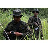A Guatemalan Army Special Forces soldier or Kaibil leads U.S. Marines of Special Purpose Marine Ai