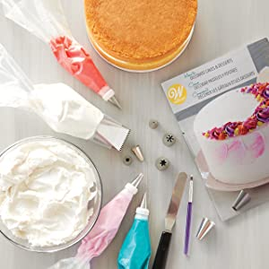 Wilton How to Decorate Cakes and Desserts Kit -39-Piece Cake Decorating Kit with Spatula, Decorating Brush, Decorating Bags, Decorating Tips, Recipes and Tutorial Video (Color: White)