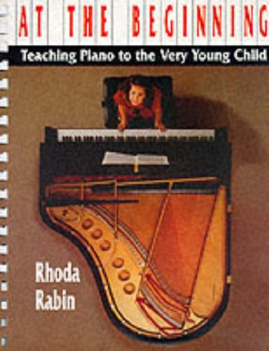 at-the-beginning-teaching-piano-to-the-very-young-child