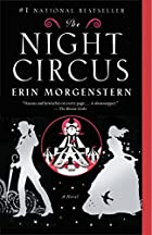 Cover art for The Night Circus. Two silver silhouettes flank a rondel in which there is a black and white circus tent topped with a large clock. The left hand silhouette is a slender man wearing a bowler hat and carrying a closed umbrella. The right hand silhouette is a slender, dancing woman wearing a full-skirted dress on which the silhouette of a lark is visible. The background is black, with silver stars around the two figures.