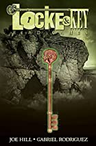 Cover art for Head Games, featuring a head-topped key overlying a rocky, seaside cliff. The cover is in tones of green.