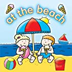 At the Beach (Out & about board books) by…