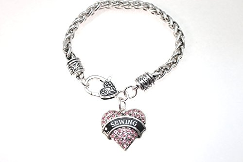 SEWING Heart Charm Bracelet is Embellished with Pink Crystal Rhinestones.