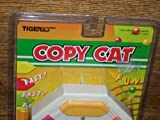 Vintage 1991 COPY CAT Computer - Roaring good Fun - Is your memory good enough to copy its funny beeps and blinking lights? The copy Cat can remember up o 32 sequences! Can you? There's two great memory games in one for your copy-catting enjoyment.