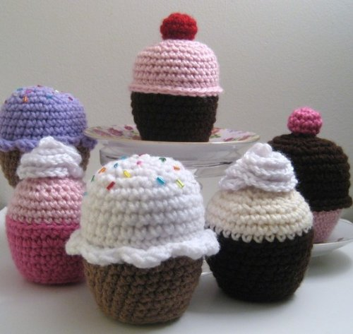Cupcake Crochet Pattern - This Crochet pattern will instruct you on how to make three original amigurumi cupcakes. Materials needed include a Size G crochet hook, Worsted weight yarns, polyester stuffing, beads, and thread for sprinkles. If made as directed, these cupcakes measure approximately 4 inches tall and 3 inches wide.
