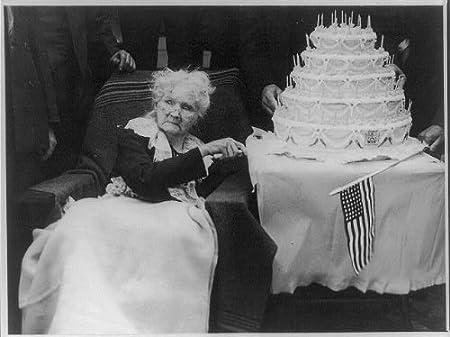 Mary Harris Mother Jones,1837-1930, cuts her birthday cake