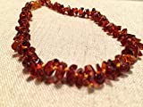 13 Inch Baltic Amber Teething Necklace for Toddler and Big Kid and some adults (Unisex) - Honey Brown Cognac Anti Flammatory, Drooling & Teething Pain Reduce Properties - Growing Pains. Certificated Natural Oval Baltic Jewelry with the Highest Quality Guaranteed. Easy to Fastens with a Twist-in Screw Clasp Mothers Approved Remedies! Helps some with colic & eczema.