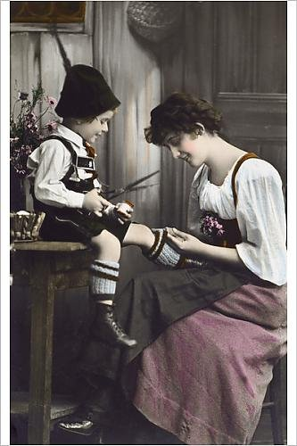 Photographic Print of German Bavarian Mother mends her young son s sock