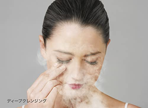 Asian woman using a home facial steamer.